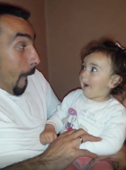 Dad and baby daughter trade funny faces
