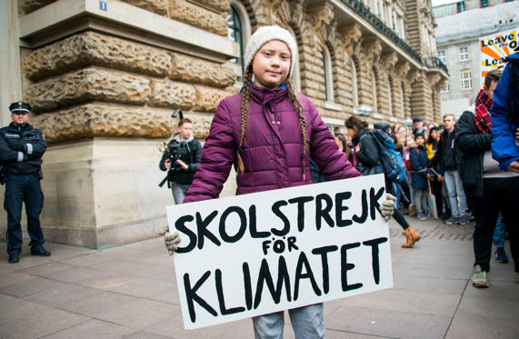 Slide 1 of 40: 01 March 2019, Hamburg: Greta Thunberg, climate activist, stands with a banner in front of a rally on the town hall market in front of the town hall. The young Swedish woman has come to Germany for the first time for a school strike for more climate protection. Photo: Daniel Bockwoldt/dpa (Photo by Daniel Bockwoldt/picture alliance via Getty Images)