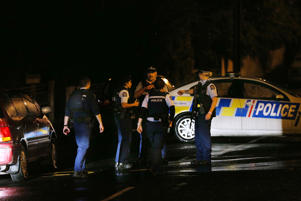 DUNEDIN, NEW ZEALAND - MARCH 15: Police investigate a property at Somerville Street on March 15, 2019 in Dunedin, New Zealand. Residents have been evacuated off the street as police investigate a property believed to be related to the deadly terror attacks in Christchurch today. At least 49 people are confirmed dead, with more than 40 people injured following attacks on two mosques in Christchurch. 41 of the victims were killed at Al Noor mosque on Deans Avenue and seven died at Linwood mosque. Another victim died later in Christchurch hospital. Three people are in custody over the mass shootings. One man has been charged with murder. (Photo by Dianne Manson/Getty Images)