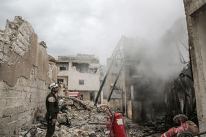 dpatop - 14 March 2019, Syria, Idlib: A Syrian White Helmet looks at a smouldering fire in the rubble of a residential building that was struck during airstrikes believed to be mounted by Russian warplanes on Wednesday. Photo: Anas Alkharboutli/dpa (Photo by Anas Alkharboutli/picture alliance via Getty Images)