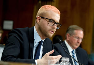Christopher Wylie testifies during a hearing before the Senate Judiciary Committee on Cambridge Analytica at Capitol Hill, Wednesday, May 16, 2018, in Washington. ( AP Photo/Jose Luis Magana)