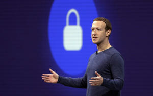 FILE - In this May 1, 2018, file photo, Facebook CEO Mark Zuckerberg delivers the keynote speech at F8, Facebook's developer conference in San Jose, Calif. Zuckerberg said Facebook will start to emphasize new privacy-shielding messaging services, a shift apparently intended to blunt both criticism of the company's data handling and potential antitrust action. (AP Photo/Marcio Jose Sanchez, File)