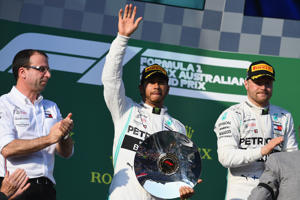 Second placed Lewis Hamilton of Great Britain and Mercedes GP celebrates on the podium during the F1 Grand Prix of Australia at Melbourne Grand Prix Circuit on March 17, 2019 in Melbourne, Australia.