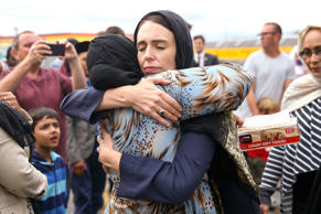 WELLINGTON, NEW ZEALAND - MARCH 17: Prime Minister Jacinda Ardern hugs a mosque-goer at the Kilbirnie Mosque on March 17, 2019 in Wellington, New Zealand. 50 people are confirmed dead and 36 are injured still in hospital following shooting attacks on two mosques in Christchurch on Friday, 15 March. The attack is the worst mass shooting in New Zealand's history. (Photo by Hagen Hopkins/Getty Images)