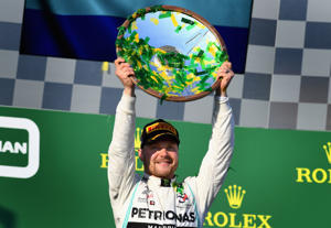 Race winner Valtteri Bottas of Finland and Mercedes GP celebrates on the podium during the F1 Grand Prix of Australia at Melbourne Grand Prix Circuit on March 17, 2019 in Melbourne, Australia.