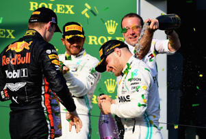 Race winner Valtteri Bottas of Finland and Mercedes GP second placed Lewis Hamilton of Great Britain and Mercedes GP and third placed Max Verstappen of Netherlands and Red Bull Racing celebrate on the podium during the F1 Grand Prix of Australia at Melbourne Grand Prix Circuit on March 17, 2019 in Melbourne, Australia.