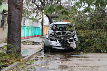 A destroyed car is seen amid the destruction provoked by the passage of the cyclone Idai in Beira, Mozambique, on March 17, 2019. - More than 120 people have died and many more are missing in Mozambique and neighbouring Zimbabwe on March 17, 2019 after tropical cyclone Idai barrelled across the southern African nations with flash floods and ferocious winds. (Photo by ADRIEN BARBIER / AFP)        (Photo credit should read ADRIEN BARBIER/AFP/Getty Images)