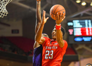 CAPTION: LUBBOCK, TX - JANUARY 28: Jarrett Culver #23 of the Texas Tech Red Raiders goes to the basket against Kouat Noi #12 of the TCU Horned Frogs during the second half of the game on January 28, 2019 at United Supermarkets Arena in Lubbock, Texas.