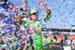 FONTANA, CA - MARCH 17: Kyle Busch (18) Interstate Batteries Toyota in Victory Lane celebrating the win at the Monster Energy NASCAR Cup Series - Auto Club 400 on March 17, 2019 at the Auto Club Speedway in Fontana, CA.  (Photo by Lyle Setter/Icon Sportswire via Getty Images)