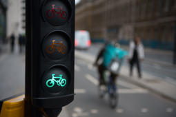LONDON, ENGLAND - MARCH 13: A general view of a cyclist riding past a green cycle traffic light   on a cycle highway on March 13, 2019 in London, England.  (Photo by John Keeble/Getty Images)