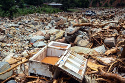 A picture shows rock and a damaged fridge among debris   on March 18, 2019 in Ngangu township, Chimanimani, Manicaland Province, eastern Zimbabwe, after the area was hit by the cyclone Idai. - A cyclone that ripped across Mozambique and Zimbabwe has killed at least 162 people with scores more missing. Cyclone Idai tore into the centre of Mozambique on the night of March 14 before barreling on to neighbouring Zimbabwe, bringing flash floods and ferocious winds, and washing away roads and houses. (Photo by Zinyange AUNTONY / AFP)        (Photo credit should read ZINYANGE AUNTONY/AFP/Getty Images)