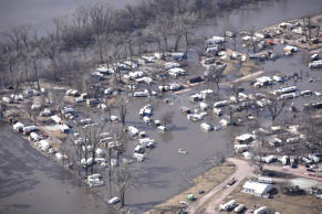In this Monday, March 18, 2019, photo taken by the South Dakota Civil Air Patrol and provided by the Iowa Department of Homeland Security and Emergency Management, shows flooding along the Missouri River in River Sioux, Iowa. (Iowa Homeland Security and Emergency Management via AP)