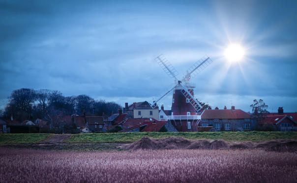 Slide 1 of 15: windmill at blakeney point early evening in norfolk uk