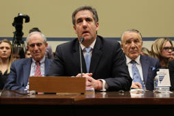 Michael Cohen, the former personal attorney of U.S. President Donald Trump, is flanked by his attorneys Lanny Davis (L) and Mike Monico (R) as he testifies before a House Committee on Oversight and Reform hearing on Capitol Hill in Washington, U.S., February 27, 2019. REUTERS/Jonathan Ernst