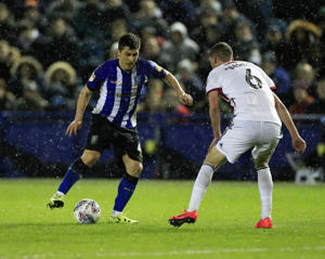 4th March 2019, Hillsborough, Sheffield, England; EFL Championship football, Sheffield Wednesday versus Sheffield United; Fernando Forestieri of Sheffield Wednesday takes on Chris Basham of Sheffield United (photo by Conor Molloy/Action Plus via Getty Images)