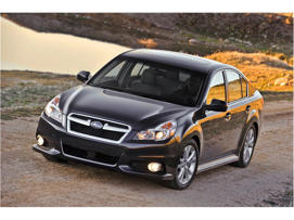 a car parked on the side of a road: 2013 Subaru Legacy