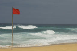 drapeau rouge red flag on the beach. (Photo by Philippe ROYER/Gamma-Rapho via Getty Images)