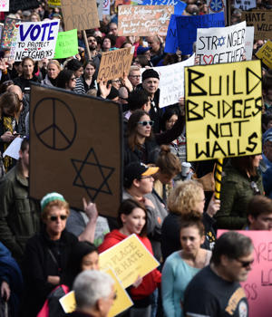 People protest the arrival of US President Donald Trump as he visits the Tree of Life Congregation on October 30, 2018 in Pittsburgh, Pennsylvania. - Scores of protesters took to the streets of Pittsburgh to denounce a visit by US President Donald Trump in the wake of a mass shooting at a synagogue that left 11 people dead. Demonstrators gathered near the Tree of Life synagogue, where the shooting took place, holding signs that read 'President Hate, Leave Our State!' and 'Trump, Renounce White Nationalism Now.' (Photo by Brendan SMIALOWSKI / AFP)        (Photo credit should read BRENDAN SMIALOWSKI/AFP/Getty Images)