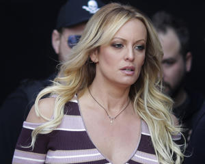 "FILE - In this Oct. 11, 2018, file photo, adult film actress Stormy Daniels arrives for the opening of the adult entertainment fair ""Venus"" in Berlin.  Daniels has sued the Columbus police department for $2 million over her arrest at a strip club last summer. The federal defamation lawsuit filed Monday, Jan. 14, 2019, alleges officers conspired to retaliate against Daniels for her sex allegations concerning Donald Trump before he became president. (AP Photo/Markus Schreiber, File)"