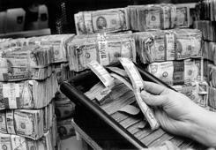 FEB 2 1987; The money as it comes in from the Banks to be sorted the good stuff put back into the money world the no good to be shredded.;  (Photo By Dave Buresh/The Denver Post via Getty Images)