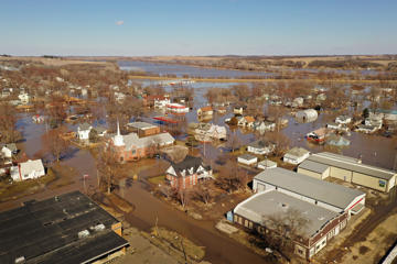 HAMBURG, IOWA - MARCH 20:  Homes and businesses are surrounded by floodwater on March 20, 2019 in Hamburg, Iowa. Several Midwest states are battling some of the worst flooding they have experienced in decades as rain and snow melt from the recent 'bomb cyclone' has inundated rivers and streams. At least three deaths have been linked to the flooding.  (Photo by Scott Olson/Getty Images)