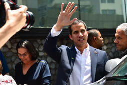 Venezuelan opposition leader and self-proclaimed interim president Juan Guaido (C) leaves after delivering a press message in Caracas, on on March 21, 2019. - President Nicolas Maduro's regime in Venezuela Thursday defied US warnings to leave the opposition alone by arresting in a predawn raid the chief of staff to Juan Guaido, recognized by Washington as the country's interim leader. Guaido and the opposition-ruled congress said on Twitter that Roberto Marrero was grabbed by SEBIN intelligence agency officers in his Caracas home and taken to an 'unknown' location. (Photo by RONALDO SCHEMIDT / AFP)        (Photo credit should read RONALDO SCHEMIDT/AFP/Getty Images)