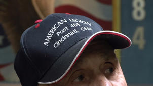 a close up of a person wearing a hat: Veterans speak out on Trump's McCain comments