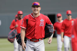 Los Angeles Angels' Mike Trout smiles as he walks onto the field with teammates before a spring training baseball game against the Arizona Diamondbacks Thursday, March 21, 2019, in Scottsdale, Ariz. (AP Photo/Elaine Thompson)