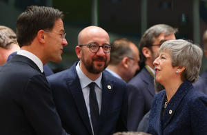 BRUSSELS, BELGIUM - MARCH 21 :   Dutch Prime Minister Mark Rutte (L) speaks with Belgium's Prime Minister Charles Michel  (C) and Britain's Prime Minister Theresa May (R) during the  EU leaders meeting in Brussels, Belgium on  21 March 2019.   (Photo by Dursun Aydemir/Anadolu Agency/Getty Images)