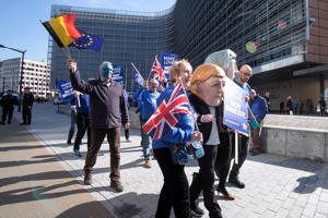 Anti-Brexit demonstration in front of the Le Berlaymon EU Commission Building before the EU Leader Summit in Brussels, Belgium. Protesters arrived by bus calling for a referendum, with EU and British flags, two of the them were wearing masks of British Prime Minister Theresa May and the German Chancellor Angela Merkel. March 21, 2019 (Photo by Nicolas Economou/NurPhoto via Getty Images)