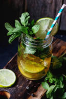 Ice green tea with ice, fresh mint, lime and lemon