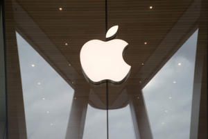 FILE- In this Jan. 3, 2019, file photo the Apple logo is displayed at the Apple store in the Brooklyn borough of New York. Apple Inc. reports earnings Tuesday, Jan. 29. (AP Photo/Mary Altaffer, File)