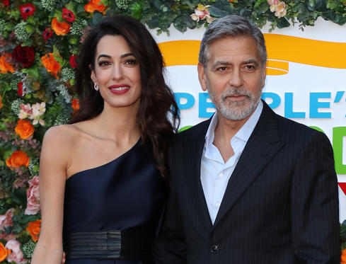 Slide 1 of 5: George Clooney and Amal Clooney attend the People's Postcode Lottery Charity Gala at McEwan Hall on March 14, 2019 in Edinburgh, Scotland.