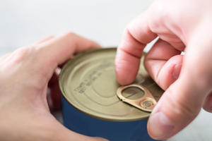 Close-up finger pull opening loop of canned food