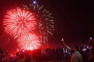 People watch a fireworks display as part of Pakistan National Day celebrations in Lahore early on March 23, 2019. (Photo by ARIF ALI / AFP)        (Photo credit should read ARIF ALI/AFP/Getty Images)