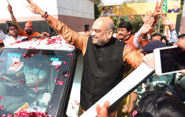 NEW DELHI, INDIA - MARCH 3: BJP Chief Amit Shah celebrates their lead in North Eastern States Elections at BJP Headquarters, DDU Marg, on March 03, 2018 in New Delhi, India. The BJP is cruising ahead in Tripura, which is considered a Left bastion. The Congress is ahead in Meghalaya in a closely watched contest. In Nagaland, the NDPP-BJP alliance is ahead. (Photo by Sanchit Khanna/Hindustan Times via Getty Images)