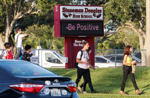 Students arrive for the the first day of classes at Marjory Stoneman Douglas High School in Parkland, Florida, U.S. August 15, 2018.  REUTERS/Joe Skipper