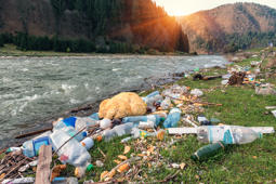 plastic garbage on the mountain river bank