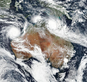 A handout photo made available by NASA on 23 March 2019 shows a satellite image of two severe tropical cyclones over northern Australia, 22 March 2019. In picture Cyclone Veronica (L) is seen over Western Australia and Cyclone Trevor over Northern Territory (top-R).