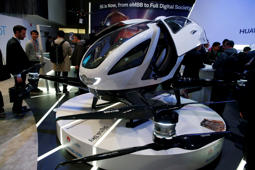 A drone taxi using 5G technology is displayed at the Mobile World Congress wireless show, in Barcelona, Spain, Tuesday, Feb. 27, 2018. The annual Mobile World Congress (MWC) runs from 26 February - 1 March and draws over 2,300 exhibitors to Barcelona, including industry heavyweights Samsung, Huawei and Nokia. (AP Photo/Manu Fernandez)
