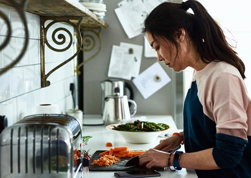 serving size definition for healthy foods woman cooking in the kitchen