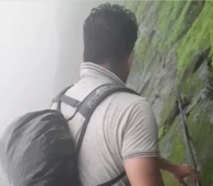 Trekker shows off terrifyingly slippery climb along cliff edge in west India