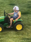 Toddler nods off while driving toy tractor