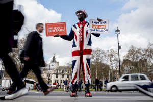 A pro-Brexit campaigner wears the Union flag colours and holds placards as he demonstrates near the Houses of Parliament in central London on April 3, 2019. - Prime Minister Theresa May was to meet on Wednesday with the leader of Britain's main opposition party in a bid to thrash out a Brexit compromise with just days to go until the deadline for leaving the bloc. (Photo by Tolga Akmen / various sources / AFP)        (Photo credit should read TOLGA AKMEN/AFP/Getty Images)