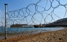 A bay with enclosures with nearly 100 whales held captive is seen through a razor barbed wire, in Russia's far eastern Primorye region, Russia, April 6, 2019. REUTERS/Yuri Maltsev