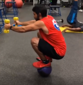 Man achieves perfectly balanced workout on top of a ball