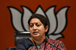 NEW DELHI, INDIA - MARCH 13: Union Textiles Minister Smriti Irani addresses a press conference at BJP headquarters, at Deen Dayal Upadhyay Marg, on March 13, 2019 in New Delhi, India. Smriti Irani alleged Robert Vadra is merely a mask in suspect land deals, while Gandhi was the real face. She said Gandhis and Vadras were the 'family package of corruption'. (Photo by Burhaan Kinu/Hindustan Times via Getty Images)