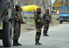 INDIA - 2017/04/01: Indian army soldiers stand alert near the shootout site where suspected rebels attacked Indian army convoy in Bemina Srinagar the summer capital of Indian controlled Kashmir on April 01, 2017. Two Indian army soldiers were injured when suspected rebels attacked an Inidan army convoy, defence officials said. (Photo by Faisal Khan/Pacific Press/LightRocket via Getty Images)