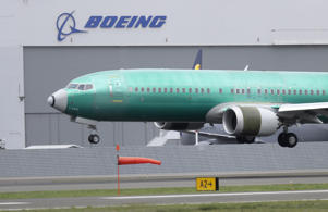 A Boeing 737 MAX 8 airplane being built for India-based Jet Airways lands following a test flight, Wednesday, April 10, 2019, at Boeing Field in Seattle. Flight test and other non-passenger-bearing flights of the plane continue in the Seattle area where the plane is manufactured, as a world-wide grounding the the 737 MAX 8 continues, following fatal crashes of MAX 8's operated by Ethiopian Airlines and Lion Air.
