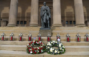 Wreaths layed by the Lord Mayor of Liverpool Christine Banks and the Mayor of Liverpool Joe Anderson are seen in front of some of the 96 lanterns arranged on the steps of St Georges Hall in Liverpool, northwest England, on April 15, 2019 to commemorate the 30th anniversary of the Hillsborough football stadium disaster in which 96 Liverpool football fans were killed. - The northern city of Liverpool remembered the 96 victims of the fatal crush at an FA Cup football tie between Liverpool and Nottingham Forest at Sheffield's Hillsborough stadium on April 15, 1989, 30 years to the day. (Photo by Paul ELLIS / AFP)        (Photo credit should read PAUL ELLIS/AFP/Getty Images)